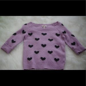 Purple sweater with black hearts